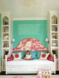 Built-In Daybed with Upholstered Headboard nestled between 2 built-in's. I would have this for my child when I have one, someday. But mine will be polka dot, with one of his or her favorite stories where the writing is.