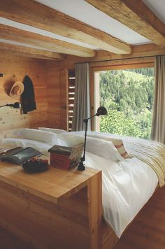 Beautiful wooden bedroom in the ultimate in getaway homes. Swiss alps cabin that…