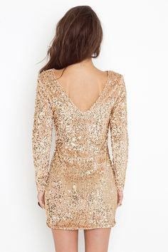 Low backed gold sequined dress