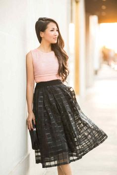 Isn't this outfit just charming? The bold black skirt pairs nicely w/ the light pink sweater-top. What a cute outfit to wear in the spring & summer.