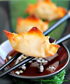 Pineapple Cream Cheese Wontons are baked, not fried! These crispy bites are dusted with Togarashi and are one of my favorite appetizer recipes.