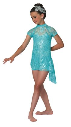 Sequin metallic lace tunic with attached drape and sleeves. Attached lycra and nude mesh shortie unitard. Available in four colors. Made in the USA. Appliqué headpiece included XS | S | I | M | L | XL | CHILD S | M | L | XL | ADULT