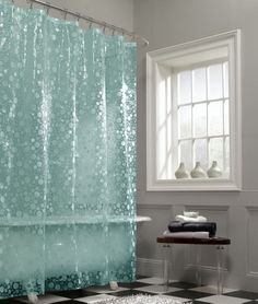 The slightly see-though lenticular bubble design on this shower curtain features fun circles and a dimensional texture