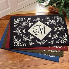 "Initial Monogram Personalized Door Mats with Scrolling Design . $22.95. A perfect accent piece to create an inviting welcome for friends and family, indoors or outdoors. Our new, exclusive design features a contemporary scroll design created of your choice of 4 warm color combinations: olive, ebony, maroon or cornflower with ivory tones.We custom personalize each mat with any single initial monogram you choose, to truly call it your own! Click the ""Preview"" button below to ..."
