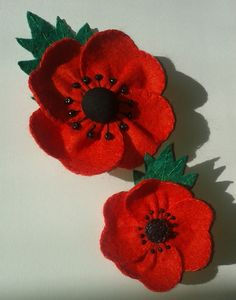 My version of the felt poppies as found on this Russian blog; http://www.livemaster.ru/topic/77751-mk-brosh-iz-fetra-mak?msec=68? . I used the top half of a heart cookie cutter to make the templates and printed off a poppy leaf drawing I found on google images to get the leaf shapes. I stiffened the green felt with a mixture of white 'school' glue and water.