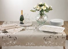 """Lorraine Embroidered And Custwork Classic Floral Table Runner. Platinum Color. One Piece. (16""""x72"""" Rectangular) by Lorraine. $24.38. platinum color. beautiful floral embroidery and cutwork design. matching tablecloth and placemat not included. made of polyester. hand wash. This beautiful table runner in modern style will add a luxurious touch to your seasonal table. Classic floral cutwork and embrodery design adds interest to this tablecloth.. Save 46%!"""