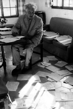 Robert Graves in his study surrounded by letters from his readers, nd -by Johnny Bonne
