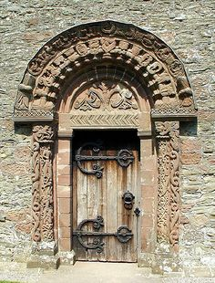 Norman doorway, mid 12th century at Kilpeck Church (aka the Parish Church of St Mary and St David in Kilpeck), located in Herefordshire near the Welsh border, is home to the finest collection of Romanesque sculpture in England. It was built in about 1140 and has survived remarkably intact and unaltered to the present day.