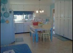 My new & improved bright white & teal kitchen!