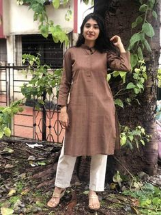 A mix of pleasant aesthetics and everyday comfort, this simplistic, easy breezy kurta is a must have for your daily wear ward robe. Pakistani Fashion Casual, Pakistani Dress Design, Pakistani Dresses, Indian Dresses, Indian Outfits, Simple Kurta Designs, Kurta Designs Women, Stylish Dresses, Simple Dresses