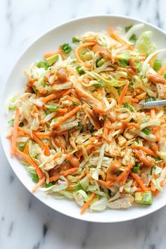 Got some chicken leftover from last night's dinner? Shred it and add it with cabbage, green onions and cilantro, and whip up a quick peanut dressing!