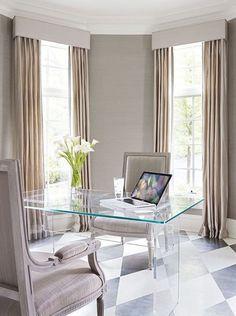 Sleek, modern home office with acrylic furniture