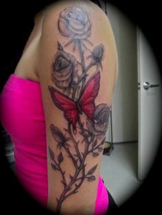 Black and grey rose flower red butterfly tattoo by greg ulibas Monter Ink Sacramento Ca