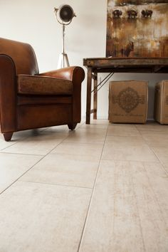 "Foundry concrete look porcelain tile by Storka flooring. Coming in three chic colors and a large format 12"" x 24"" size, this modern industrial look tile looks equally as stunning in a traditional living room as in trendsetting a downtown loft."
