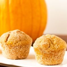 Pumpkin Doughnut Muffins – Baked and tossed in cinnamon-sugar!