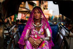 She was not going to a celebration, but just to the market. This kind of spectacular outfits are common things in India.  I photographed her 2 days ago in Jodhpur, India.