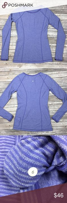 """Lululemon Run: Turn Around Long Sleeve Reversible Excellent condition.  Lululemon Run: Turn Around Long Sleeve. Size 6. Details include: thumbholes, side pocket for key/card and it's reversible!  Color is Persian Purple Heathered Persian Mini Check/Reflective Sparkle Splatter. Fabric: Rulu four way stretch, moisture wicking, quick drying, preshrunk, chafe resistant. Approximate measurements  Armpit-Armpit: 19"""" Length: 28""""  No visible flaws or defects.  Please refer to photos as they provide…"""
