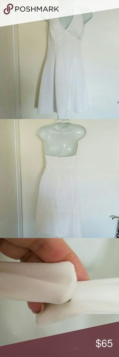 Moda International White Halter Dress, Size 12 Such a gorgeous eternally classic dress purchased from Victoria's Secret by Moda International.  The halter fastens at the back of the neck, and it's a wonderful fit and flared dress.  Beautiful, never worn, no flaws! Moda International Dresses