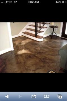 Stained concrete!!! Forget wood, tile, carpet, this is where it's at!
