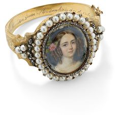 Elaborate foliate engraved hinged bangle composed of a central oval locket containing a portrait plaque of a young girl set within a rose-cut diamond and pearl frame to similarly set rose-cut diamond foliate and pearl shoulder detail, the reverse plaque depicting a similar portrait of a young girl, the inside engraved and dated 1803-38.