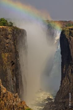 Victoria Falls, Zambia / Zimbabwe   Awesome view! Love the rainbow which reminds me of the promise of God!