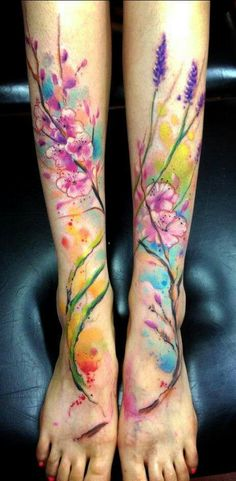 cherry blossoms and lavender with colorful background- love this style of tattoo rendering, wonder what artist around here could actually do that or even be willing? :/