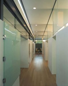 chairs at end of hallway.  wood floors plus glass let the light pour in