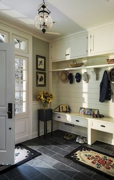 Would love my entry way, mud room,to have some of these features: Love the windows around the door and the plank walls, the color, oh my!