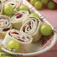 Gooseberry Patch Recipes: High Rollers - tortilla roll-ups filled with ham, honey-nut cream cheese and sweetened dried cranberries.