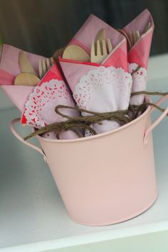 Wrap doilies around utensils and light pink napkin, tie with ribbon.