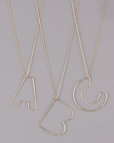 Letter-Pendant Necklaces by GaugeNYC at Neiman Marcus.