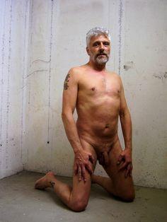 nude man in a concrete cellar