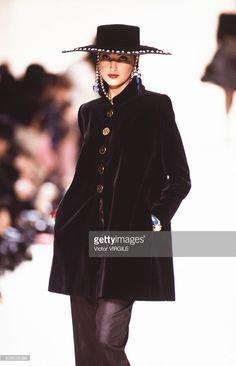 A model walks the runway at the Yves Saint Laurent Ready to Wear Fall/Winter 1992-1993 fashion show during the Paris Fashion Week in March, 1992 in Paris, France.