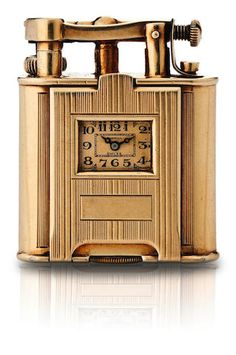 Dunhill. A fine and rare 14ct gold manual wind watch set on a cigarette lighter Case No. 137, Circa 1930s