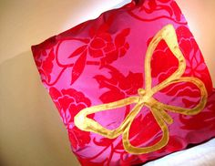 Luxurious raspberry taffeta. Red velvety detailing. A stunning golden butterfly. This cushion cover will bring opulence and drama to any room.     Take a look at our bright and festive home decor items at www.CreativeHomeDecorations.com