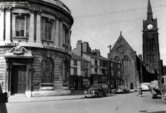 The Midland Bank on the corner of Oldham Road and Swan Street. In the image you can see the church of St Vincent. This was demolished approximately 1970. Roughly where the van is parked there used to be a trough for horses to take water.