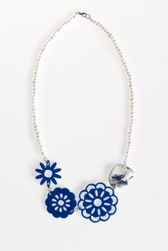 Acrylic Flower and Folded Porcelain Pearl Necklace- Navy blue acrylic flowers are strung with a folded porcelain disc and freshwater pearls. The disc started as a piece of soft clay that were hand molded, crafted, and painted with blue glaze to highlight Hand Molding, Acrylic Flowers, Laser Cut Acrylic, Fresh Water, Jewelry Collection, Indigo, Pearl Necklace, Porcelain, Clay
