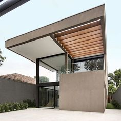 Drucker Arquitetura's Hermanas Houses are side-by-side houses in a leafy neighborhood of São Paulo/ Solar panels and rainwater reuse are aspects that make the homes contemporary in their sustainability standards/ Explore this on . Building Design, Solar Panels, Tiny House, Facade, Swimming Pools, Pergola, The Neighbourhood, Outdoor Structures, Contemporary