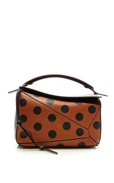 This **Loewe** bag is rendered in calf leather and features a top handle and can be zipped into various silhouettes.