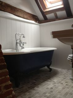 Bath painted in 'Hague Blue', panels painted in 'Wevet' - both Farrow & Ball'