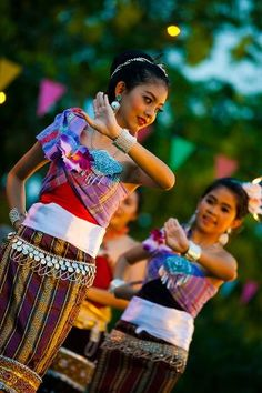 A cute Thai girl performs a native dance in colorful garb for Songkran, Thai new year.