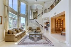 TWO-STORY LIVING ROOM. #DELRAYBEACH #HOMEDECOR #LUXURYREALESTATE #LUXURYHOME