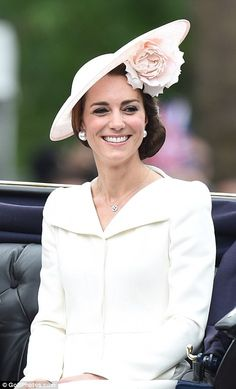 The Duchess of Cambridge smiles at crowds...