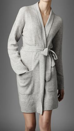 Long sleeve dressing gown in a soft knitted cashmere The dressing gown is open at the front with wraparound tie closure The open front has contrasting knit panels from the back of the neck to the front hemline Two front oversize patch pockets with ribbed trim Tonal check ribbon trims the sleeve c...