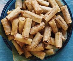 Lumpia Shanghai (Filipino Spring Rolls)  Only use 2 tbsp each of soy and fish sauce. Cut in thirds