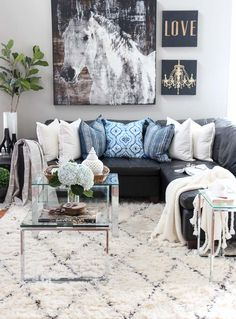 Summer home tour and summer decorating ideas. Indigo, black and gray Family room with horse art, indigo shibori pillows, ikat pillows, Moroccan shag area rug, chrome and glass tables, fiddle leaf fig, tasseled throw blanket.