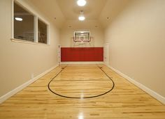 #HomeOwnerBuff A Home Basketball court, up in the windows could be the home gym.