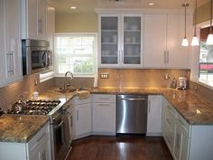 I would LOVE to have white cabinets.  I love this counter top and backsplash.