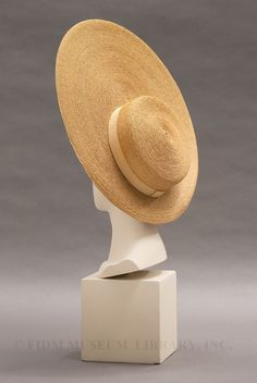 Karl Lagerfeld (b. 1938) has reinterpreted this now-classic millinery design in multiple collections, both for Chanel and for his eponymous label, as shown here.