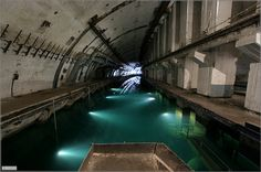 Abandoned Submarine Base in Balaklava, Ukraine - This image of an abandoned subway tunnel was captured in the metro system underneath Kiev, Ukraine. Many of the tunnels are partially flooded, and stalactites hang from the ceilings.